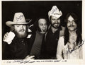 Music Memorabilia:Autographs and Signed Items, ZZ Top Signed and Inscribed Glossy Black and White Photo (1977)....