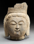 Carvings, A Chinese Carved Stone Head of Guanyin, Song Dynasty . 15-1/2 x 10 x 8-1/2 inches (39.4 x 25.4 x 21.6 cm). ...