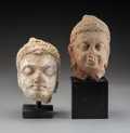 Carvings, Two Kushan-style Carved Sandstone Heads of Buddha. 6 x 5-1/2 inches (15.2 x 14.0 cm) (largest, excluding stand). ... (Total: 2 Items)