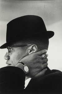Eve Arnold (American, 1913-2012) Malcom X, Chicago, 1961 Gelatin silver, printed later 14 x 9-3/8