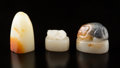 Carvings, A Group of Three Chinese Jade Seals. 1-5/8 x 0-7/8 x 1 inches (4.1 x 2.2 x 2.5 cm) (tallest, pendant). ...