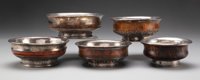 A Group of Five Tibetan Silver and Burlwood Bowls Marks to one: Inset Yuan Shikai Dollar Coin (1914) 2-1/4 x 5-