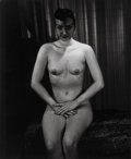Photographs, Weegee (American, 1899-1968). Seated Nude with Fishnet Veil, circa 1940s. Gelatin silver, 1950s. 13 x 10-5/8 inches (33....