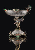 Silver & Vertu, A Hermann Ratzersdorfer Gem-Set, Partial Gilt, and Enameled Silver-Mounted and Engraved Rock Crystal Figural Tazza, Vienna, ...