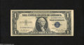 Error Notes:Skewed Reverse Printing, Fr. 1614 $1 1935E Silver Certificate. Choice About ...