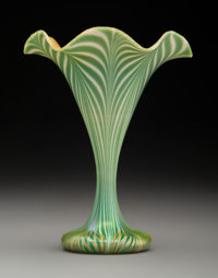 Quezal Pulled Feather Glass Floriform Vase, circa 1910 Marks: Quezal, R, 401 6-3/4 inches (17.1 cm)  PROPERTY FROM T