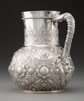 Silver & Vertu, A Tiffany & Co. Repoussé Silver Water Pitcher with Mask