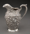 Silver & Vertu, A Schofield Mfg. Co. Baltimore Rose Pattern Repoussé Silver Water Pitcher, Baltimore, Maryland, early 20th centu...