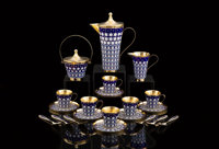 A Twenty-Two-Piece Soviet-Era Russian Partial Gilt and Cloisonné Enameled Silver Tea and Coffee Service in Origin...