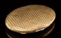 A Continental 18k Gold Compact, circa 1920 Marks: 750 3-3/8 inches (8.6 cm)
