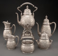 Silver & Vertu, A Six-Piece Tiffany & Co. Repoussé Silver Tea Service in the Persian Taste, New York, 1874-1891. Marks: TIFFANY & CO, MAKE... (Total: 6 )
