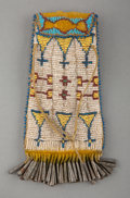 American Indian Art:Beadwork and Quillwork, An Apache Beaded Hide Strike-A-Light Bag...