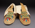American Indian Art:Beadwork and Quillwork, A Pair of Santee Sioux Beaded Hide Moccasins... (Total: 2 )