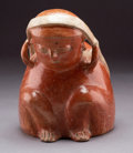 Pre-Columbian:Ceramics, A Seated Figure with Tumpline and Bag...