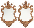 Furniture, A Pair of Italian Carved Hardwood Cartouche Mirrors. 43 x 26 x 8 inches (109.2 x 66.0 x 20.3 cm) (each). ... (Total: 2 Items)