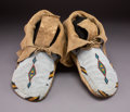 American Indian Art:Beadwork and Quillwork, A Pair of Assiniboine Beaded Hide Moccasins...