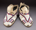 American Indian Art:Beadwork and Quillwork, A Pair of Ute Beaded Hide Moccasins...
