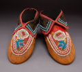 American Indian Art:Beadwork and Quillwork, A Pair of Iroquois Beaded Hide Moccasins...