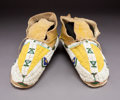 American Indian Art:Beadwork and Quillwork, A Pair of Arapaho Beaded Hide Moccasins...