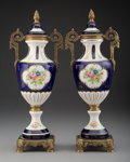 Ceramics & Porcelain, A Pair of Sèvres-Style Bronze-Mounted Painted and Partial-Gilt Porcelain Urns, 20th century. Marks: 3839. 15 x 6-1/4 x 4... (Total: 2 Items)