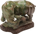 Carvings, A Continental Carved Stone Figure of a Rhinoceros on a Wood Base. Marks: Zibute. 14 x 20 x 12 inches (35.6 x 50.8 x 30.5...