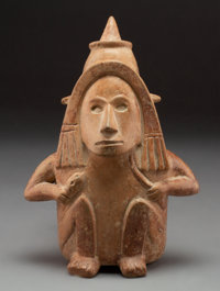 A Colima Seated Figure Wearing Pointed Helmet