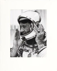 Gemini 6A: Large Vintage Silver Gelatin Photo of Wally Schirra Putting on His Helmet Pre-Flight