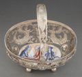 Silver & Vertu, A German Reticulated Silver and Porcelain Basket, 19th century. Marks: (crescent-crown), 800, (J-swan-K), (various pseud...