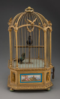 A Swiss Gilt Metal Singing Bird Cage with Porcelain Panels, 20th century 15-1/2 x 11-1/2 x 10-1/4 inches (39.4 x 2