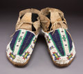 American Indian Art:Beadwork and Quillwork, A Pair of Sioux Beaded Hide Moccasins...