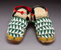 American Indian Art:Beadwork and Quillwork, A Pair of Plains Beaded Hide Moccasins ...