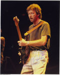 Music Memorabilia:Photos, Eric Clapton Signed Color Photo....