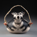American Indian Art:Pottery, A Cochiti Polychrome Canteen...