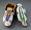 American Indian Art:Beadwork and Quillwork, A Pair of Sioux Pictorial Beaded Hide Ceremonial Moccasins...