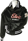 "Music Memorabilia:Memorabilia, ""Elvis In Concert"" Tour Jacket. A black nylon jacket with an ""Elvisin Concert"" patch sewn over the left breast and a ""TCB"" ..."