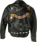 Music Memorabilia:Memorabilia, Leather Jacket Signed by Bruce Springsteen, Cher and Others. Ablack leather motorcycle jacket adorned with conchos, a sheri...