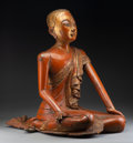 Carvings, A Burmese Glass Inlaid, Carved, and Lacquered Giltwood Figure of a Seated Monk, late 19th century . 24-1/2 x 17 x 25-1/2 inc...