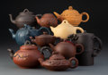 Ceramics & Porcelain, A Group of Ten Chinese Yixing Pottery Teapots. Marks to tallest: Four-character mark. 5-3/4 x 6 x 3 inches (14.6 x 15.2 x 7.... (Total: 10 Items)