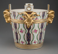 A Sèvres Partial Gilt Porcelain Milk Pail with Applied Ram's Heads, France, 19th century Marks: (crossed L's in u...