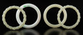 Jewelry, A Group of Four Chinese Jade Bangles. 3-1/8 x 0-3/8 inches (8 x 1 cm) (largest, pale apple). ... (Total: 4 Items)
