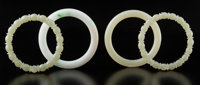 A Group of Four Chinese Jade Bangles 3-1/8 x 0-3/8 inches (8 x 1 cm) (largest, pale apple)