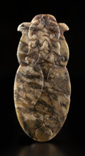 Carvings, A Chinese Mottled Jade Cicada, Ming Dynasty or earlier. 3-1/8 x 1-3/8 x 0-3/8 inches (7.9 x 3.5 x 1.0 cm). ...