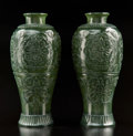 Carvings, A Pair of Chinese Mughal-Style Spinach Jade Baluster Vases. 7-1/2 x 3-1/4 inches (19.1 x 8.3 cm) (each, excluding stands). ... (Total: 2 Items)
