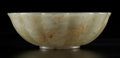 Carvings, A Mughal-Style Celadon Jade Bowl, 19th century . 1-3/8 x 4-1/4 inches (3.5 x 10.8 cm). ...