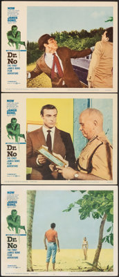 "Dr. No (United Artists, 1962). Fine/Very Fine. Lobby Cards (3) (11"" X 14""). Mitchell Hooks Border Artwork. Jam..."