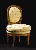 Furniture: French, A French Louis XVI Style Carved Slipper Chair. Unknown maker,French. Nineteenth Century. Wood. Unmarked. 30.5 inches tall...