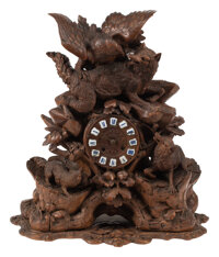 A Black Forest Carved Walnut Figural Clock, 19th century 21 x 20 x 8-1/2 inches (53.3 x 50.8 x 21.6 cm)