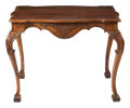 Furniture, An Italian Renaissance-Style Carved Walnut Center Table, 18th century . 32 x 42-1/2 x 29-1/2 inches (81.3 x 108.0 x 74.9 cm)...