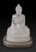 Carvings, A Carved Rock Crystal Figure of a Seated Buddha on Silvered Wood Base. 13 x 10 x 7-1/2 inches (33.0 x 25.4 x 19.1 cm). ...