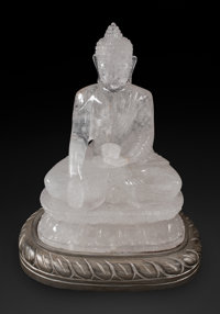 A Carved Rock Crystal Figure of a Seated Buddha on Silvered Wood Base 13 x 10 x 7-1/2 inches (33.0 x 25.4 x 19.1 c